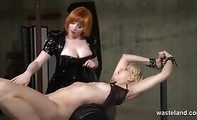 Arousing Lesbian Femdom BDSM Action With Chains Whips And Lust