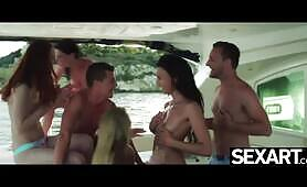 Gorgeous bikini babes have passionate lesbian sex on a party boat